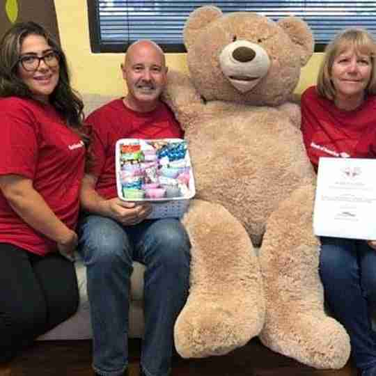 Teddy Bear Cancer Foundation with volunteers and a big bear.