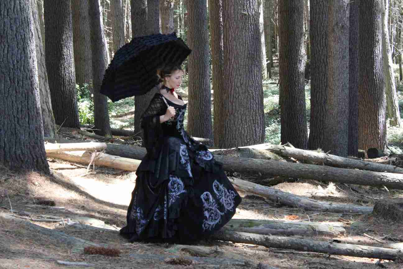 Silvia walking through the Sugar Pine Forest wearing the Gallery Serpentine Gothic Baroque Srolls Gown