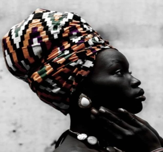 As a Black Owned Beauty Brand We Know Dark Skin Has Specific Skincare Needs | Absolute JOI | Image of Beautiful African American Woman