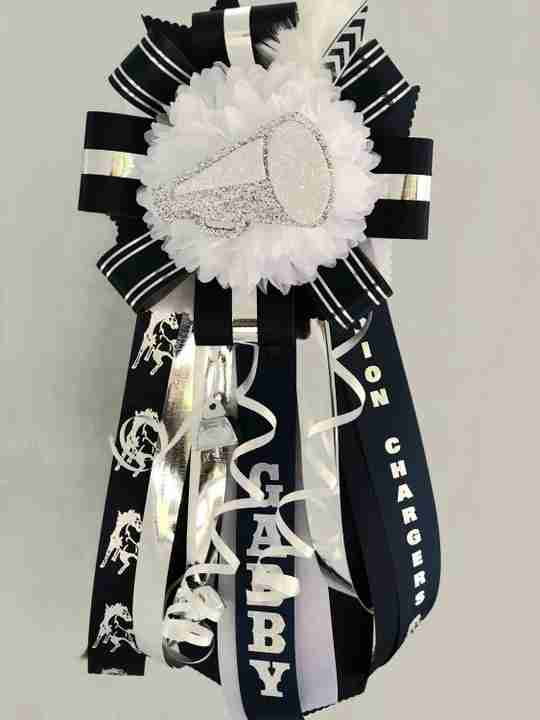 A black and white homecoming mum.