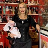 Silvia's profile pic at her Dolls Museum at Monte Cristo wearing a Gallery Serpentine over bust corset and holding one of her reborn doll creations
