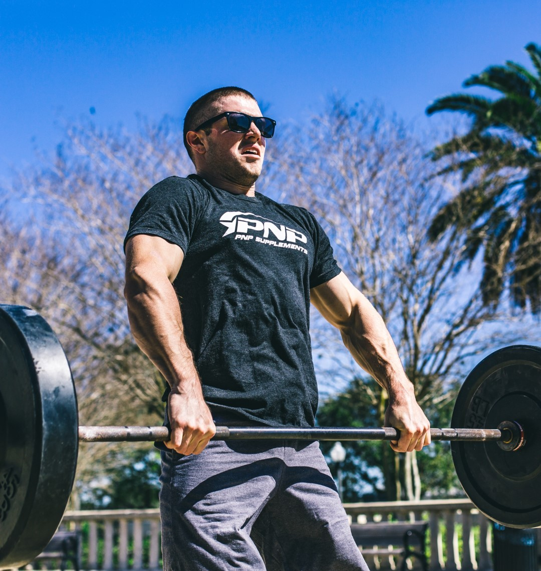 a athlete building explosive strength power with Olympic weightlifting