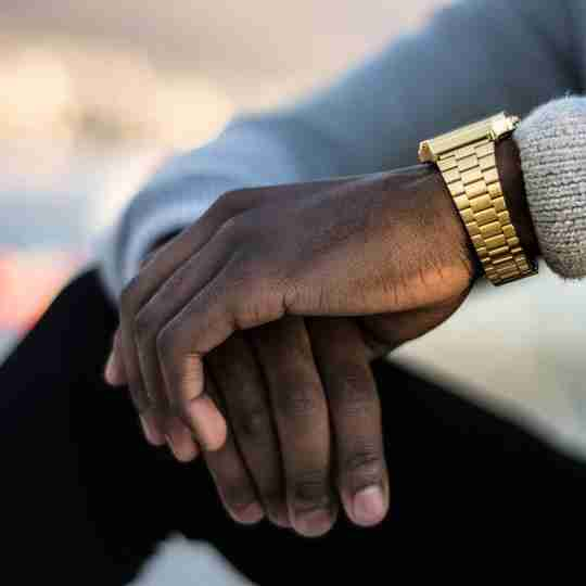 Man wearing gold wrist watch