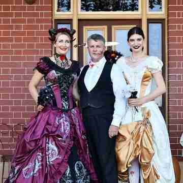 Silvia Sophia and Lawrence getting ready for Halloween, the ladies are both wearing Gallery Serpentine corset gowns