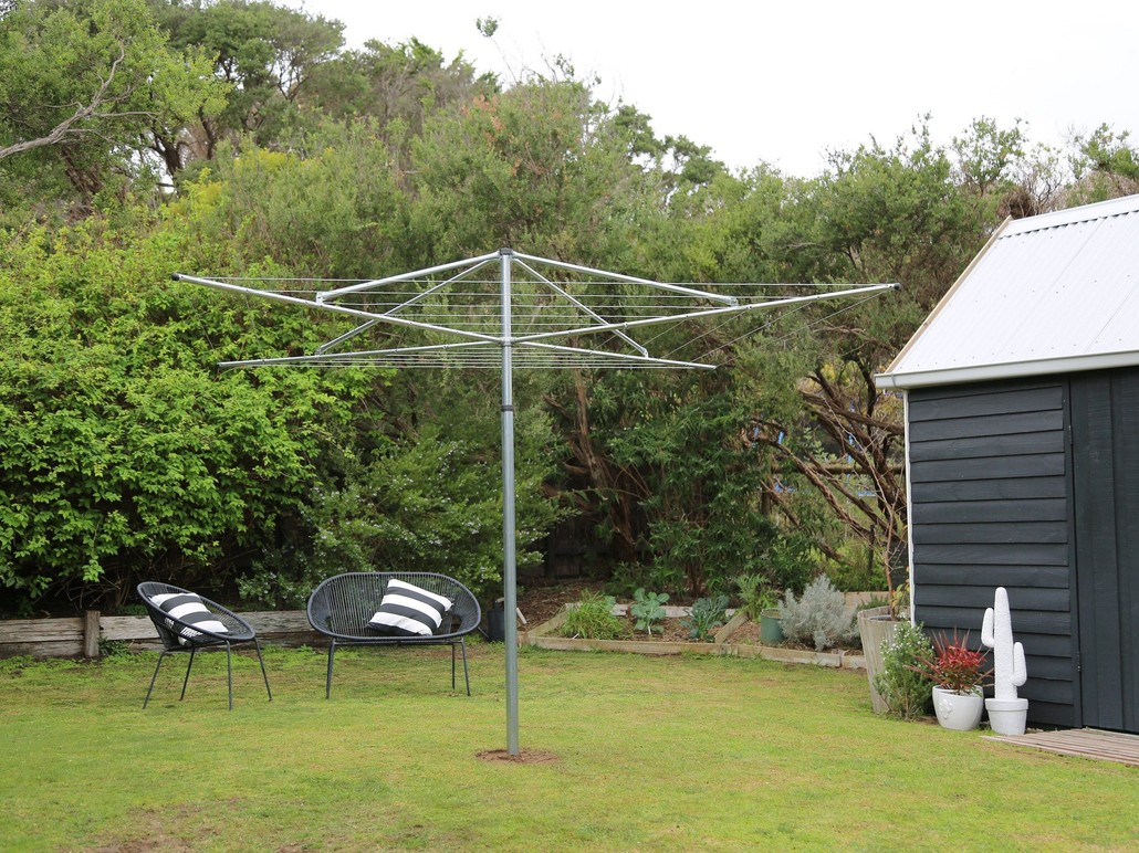 freestanding hills hoist clothesline installed into grass area
