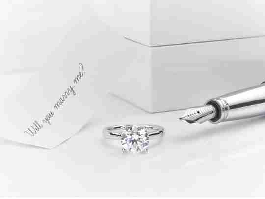 1 carat diamond engagement ring and marry me note