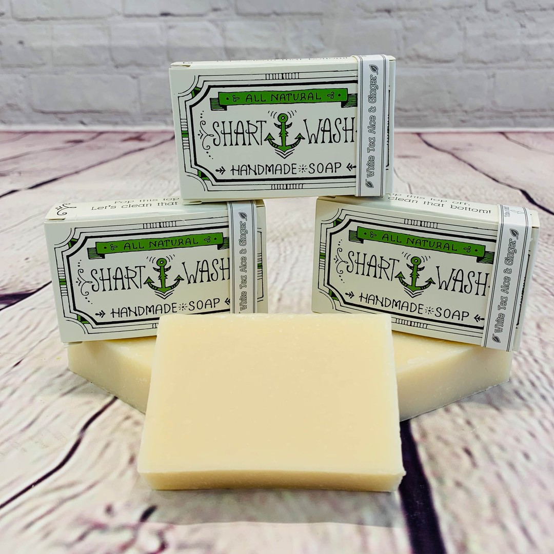 picture of 3 bars of white shart wash natural handmade soap bars on a wood background