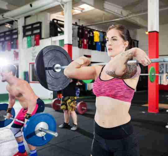CrossFit athletes doing clean and jerks after consuming a citrulline supplement.