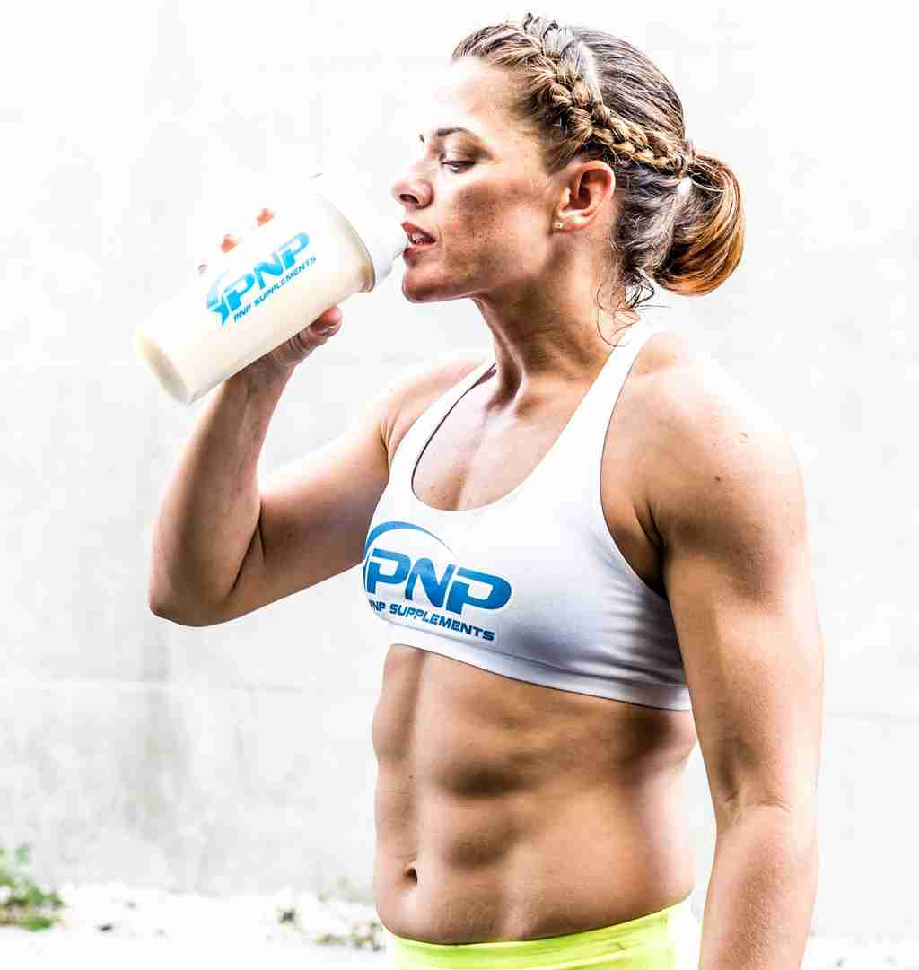 CrossFit athlete Luisa Porras drinking grass-fed whey protein isolate for its benefits.