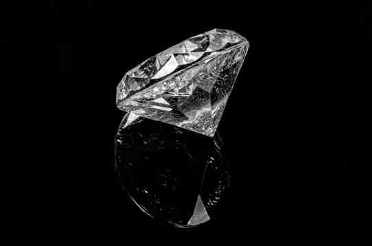 Colorless diamond on a black background