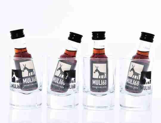 Muli Kennenlernpaket mit 4 leckeren Kräuterlikören und 4 Muli Shot Gläsern