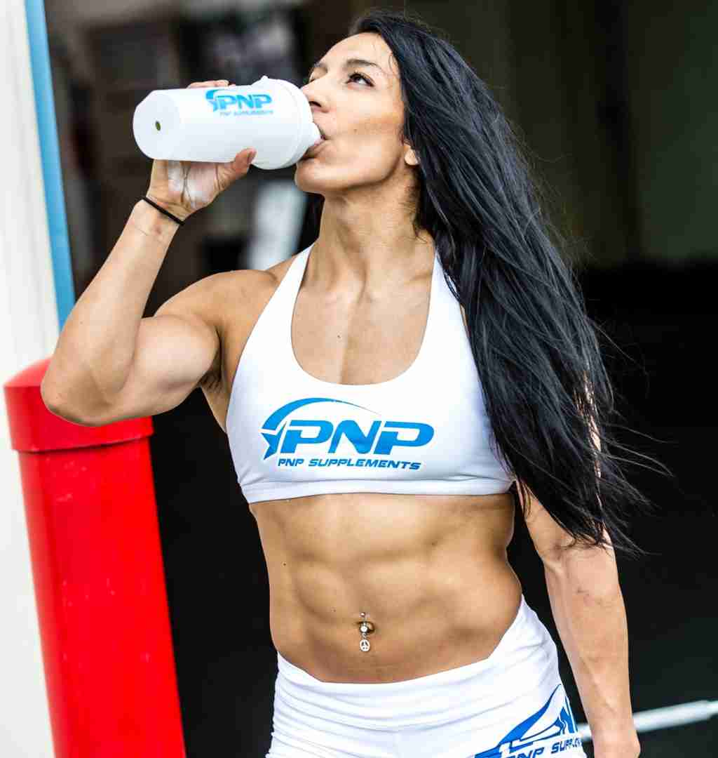 Female CrossFit athlete Rachel Garibay optimizing her high protein diet by drinking a Grass-Fed Whey Protein Isolate and Colostrum protein shake by PNP Supplements.