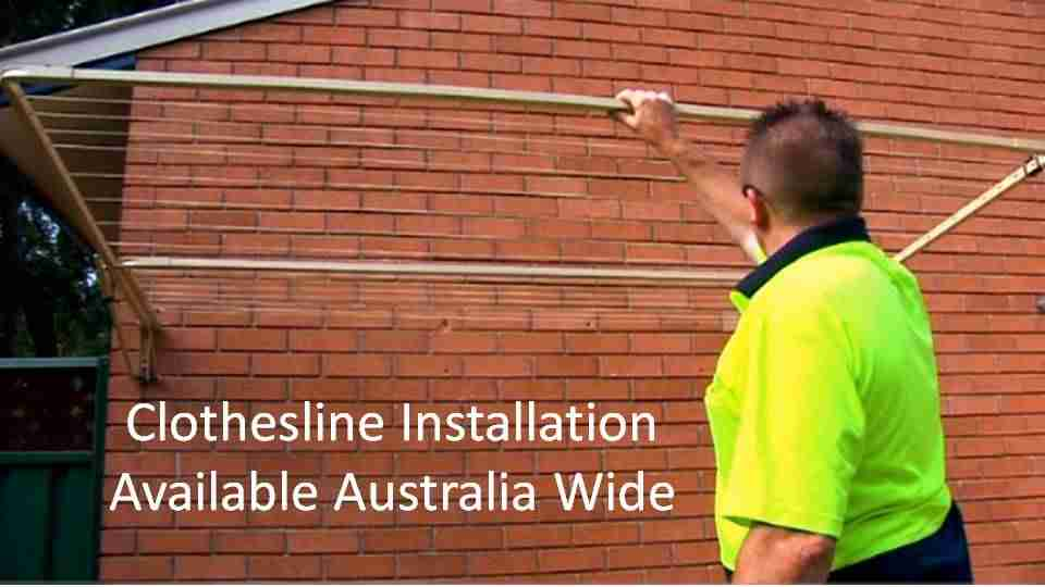 2300mm wide clothesline installation service showing clothesline installer with clothesline installed to brick wall