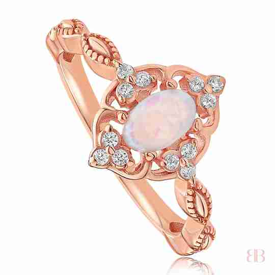 Rose gold ring with a front bezel holding an oval stone in the middle
