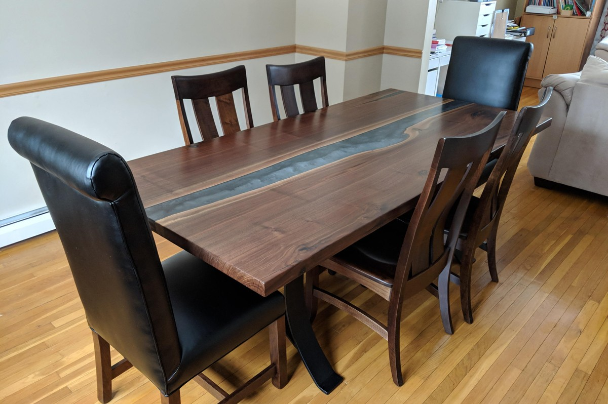 live edge walnut dining table with gray epoxy river