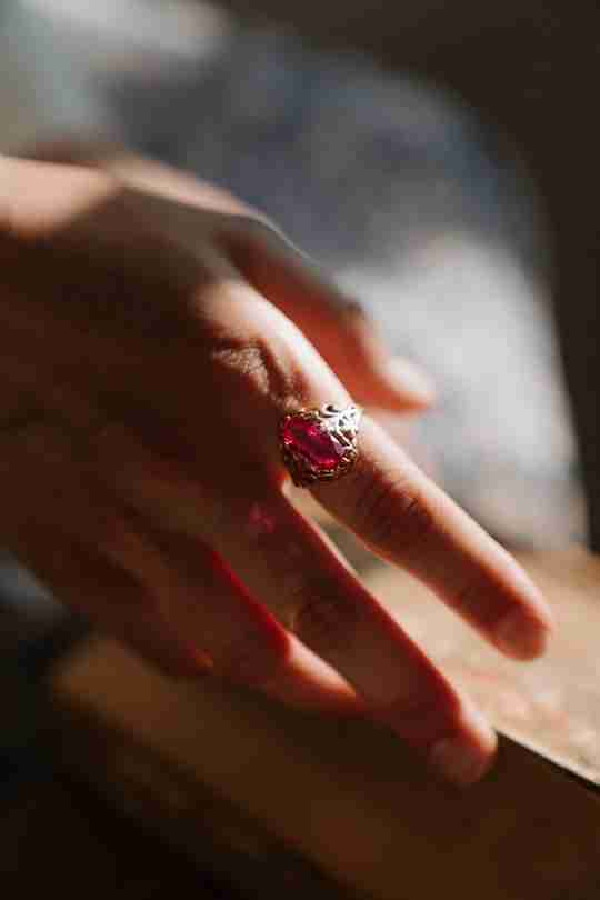 Ruby ring on index finger
