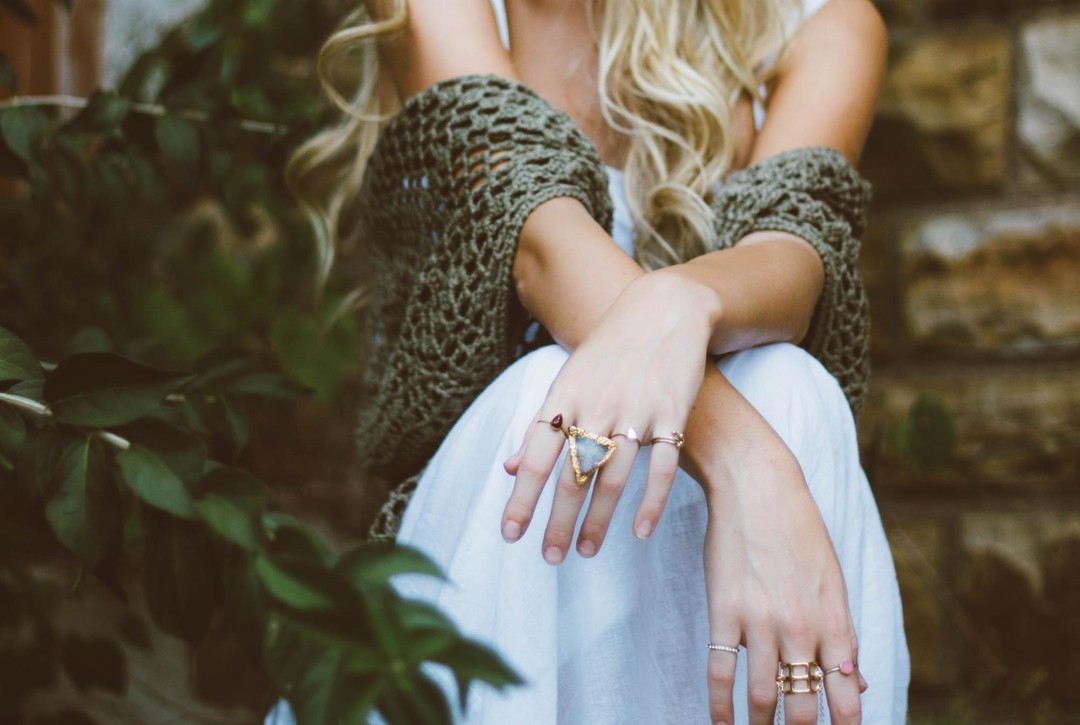 Woman wearing multiple rings