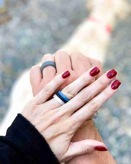 A couple wearing QALO rings