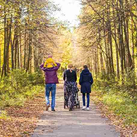 Family walking in a park