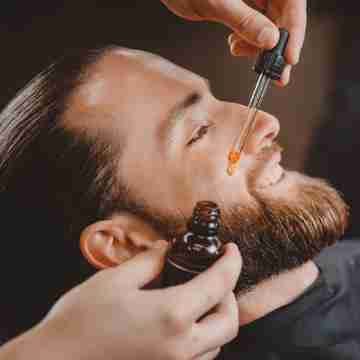 man with beard oil