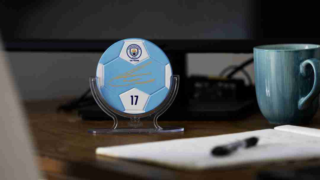 Manchester City collectible displayed in stand