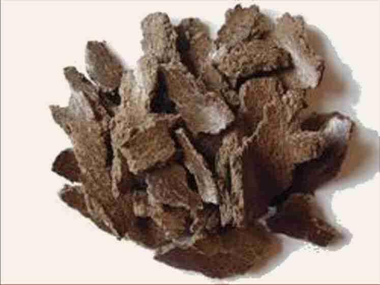 Dark brown shavings of Butter Tree Bark