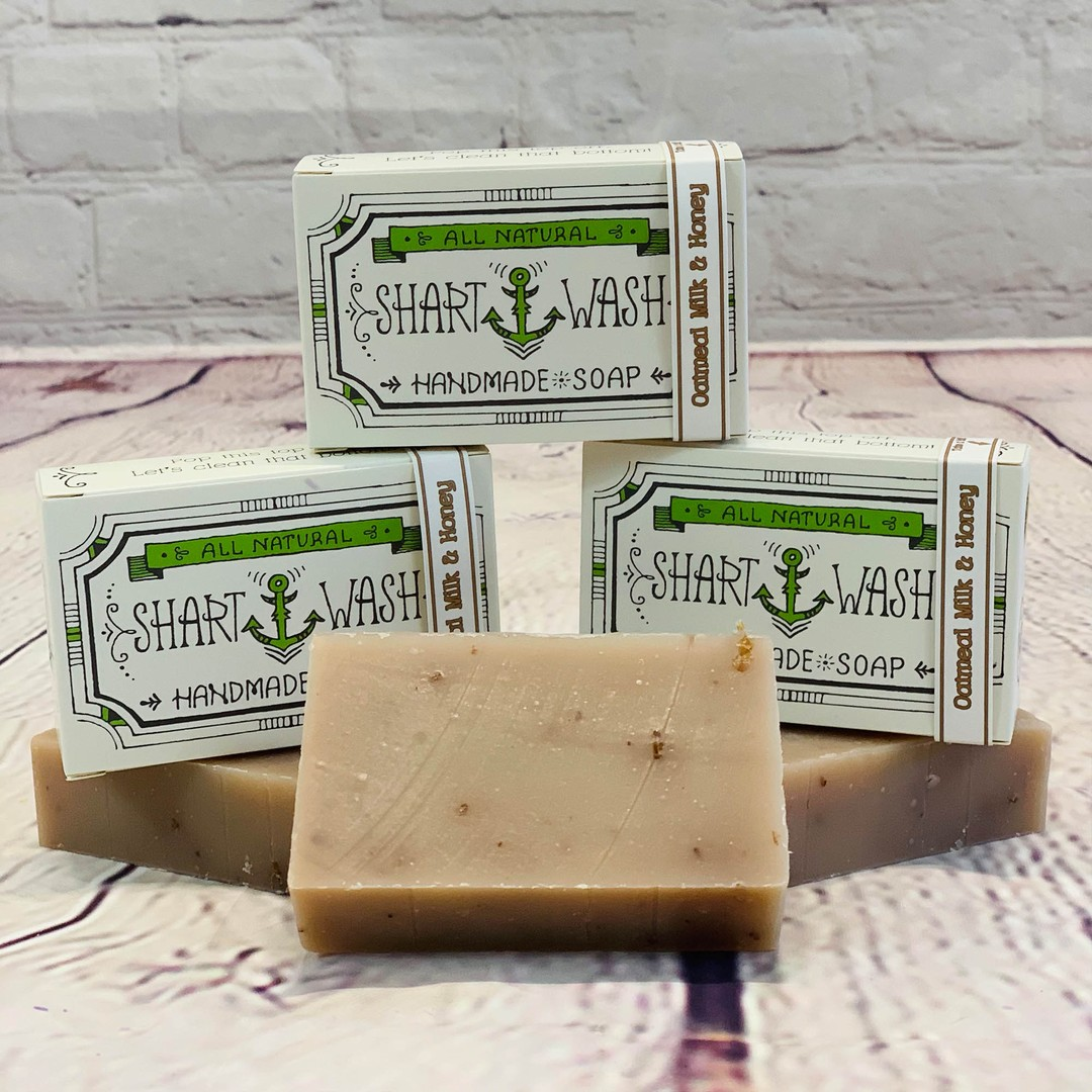 picture of 3 bars of tan shart wash natural handmade soap bars on a wood background