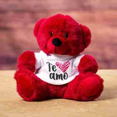 Sitting red bear wearing a white t-shirt