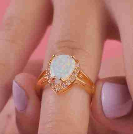 White Fire Champagne Opal Ring on a finger
