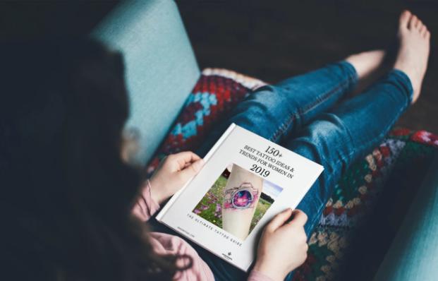 Girl reading Inked Ritual 150+ Tattoo Ideas for women Free E-Book