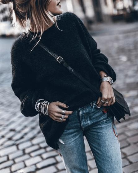 girl in black wearing a lot of bracelets